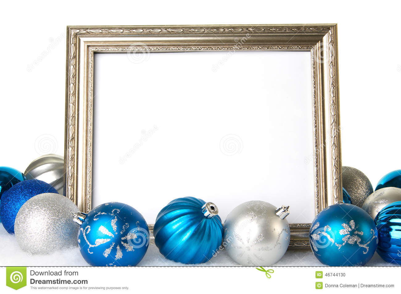 Picture frame christmas ornaments - An Empty Silver Picture Frame With Blue And Silver Christmas Ornaments