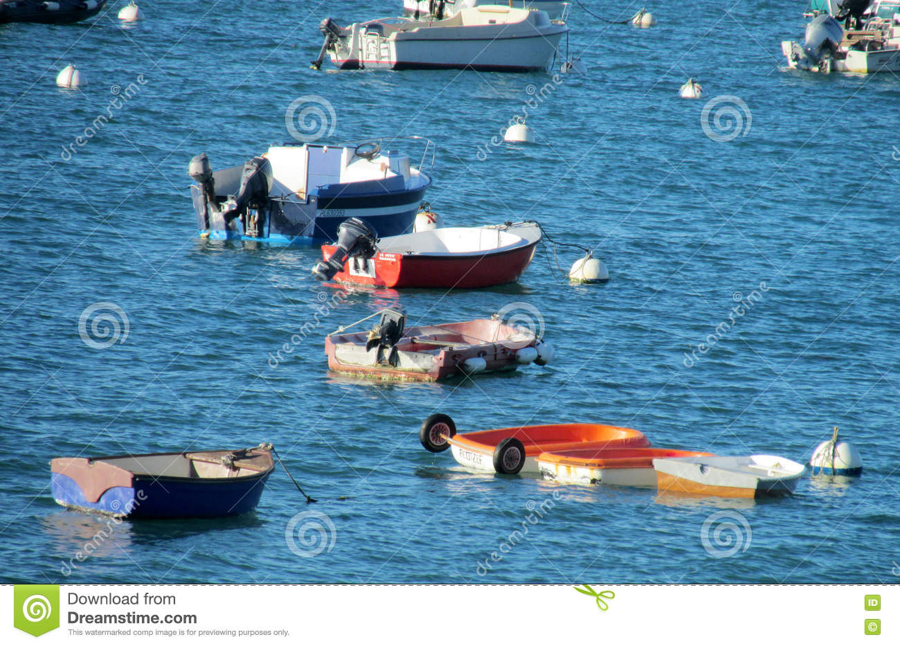 Empty small fishing boats in water