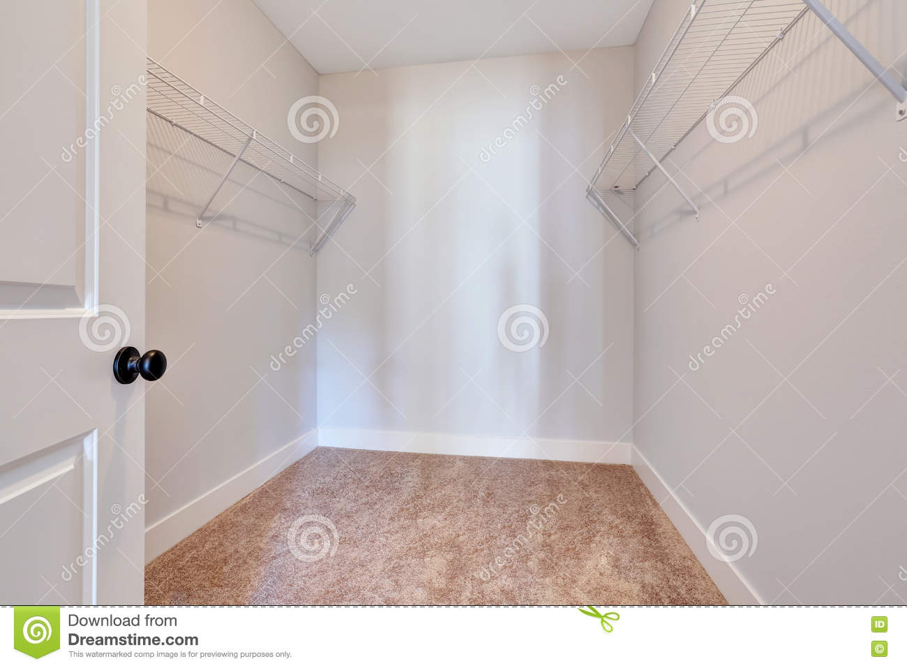 empty walk in closet beautiful empty small walkin closet with shelves and carpet floor small walkin closet with shelves and carpet floor stock photo