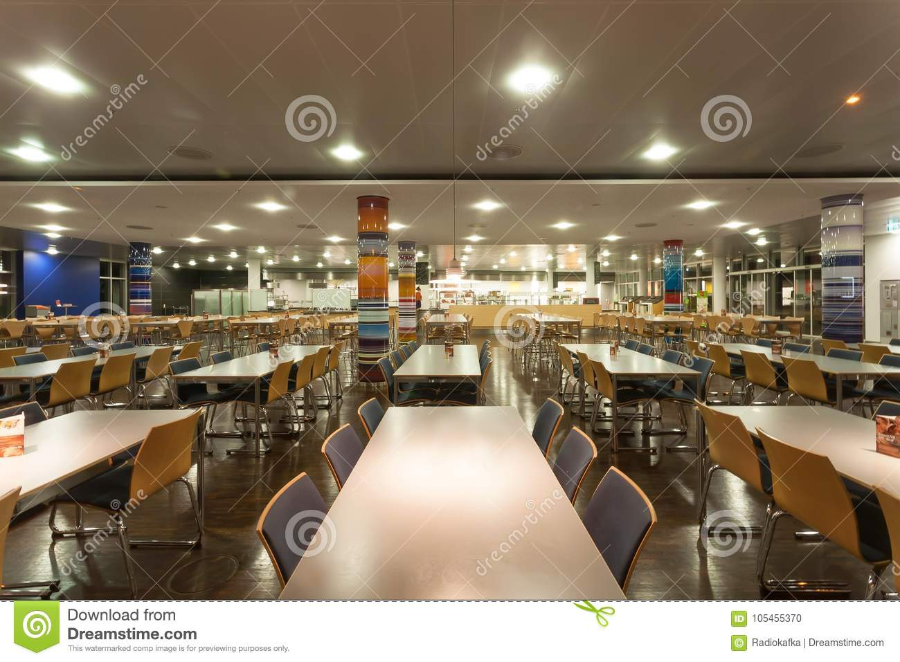Munich germany november 17 2017 empty space of huge cafe with bright lamps and tables in modern furniture style on november 17 2017