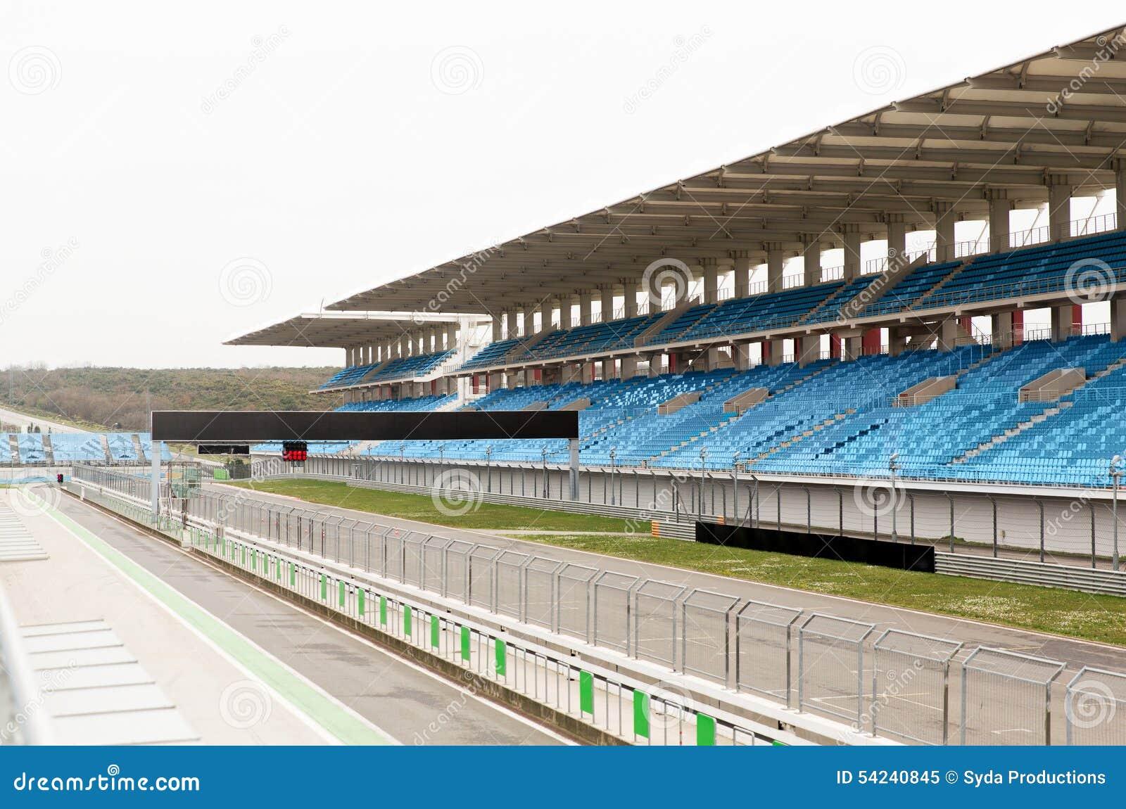 Empty Speedway And Bleachers On Stadium Stock Photo