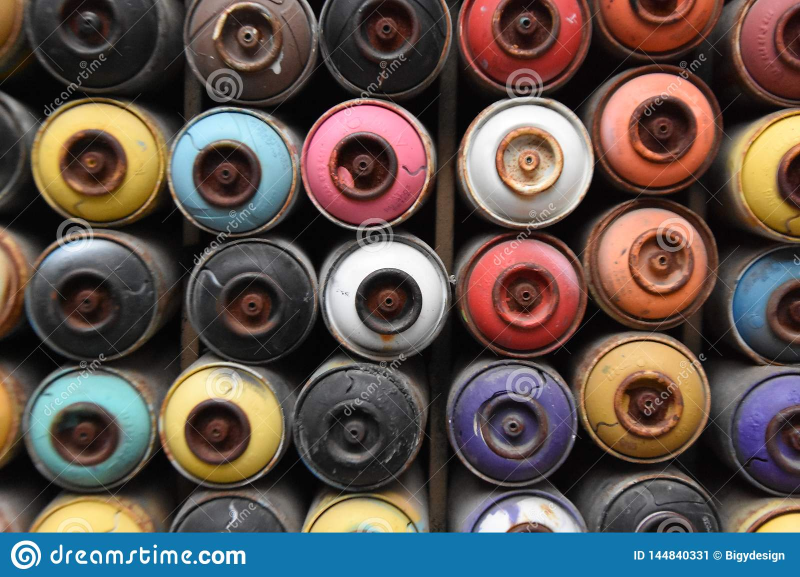 Empty spray cans, colorful