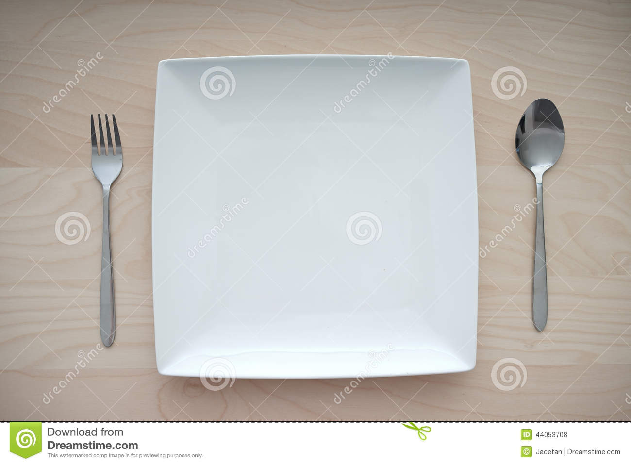 Empty square plate on wooden table with fork and spoon for Table utensils