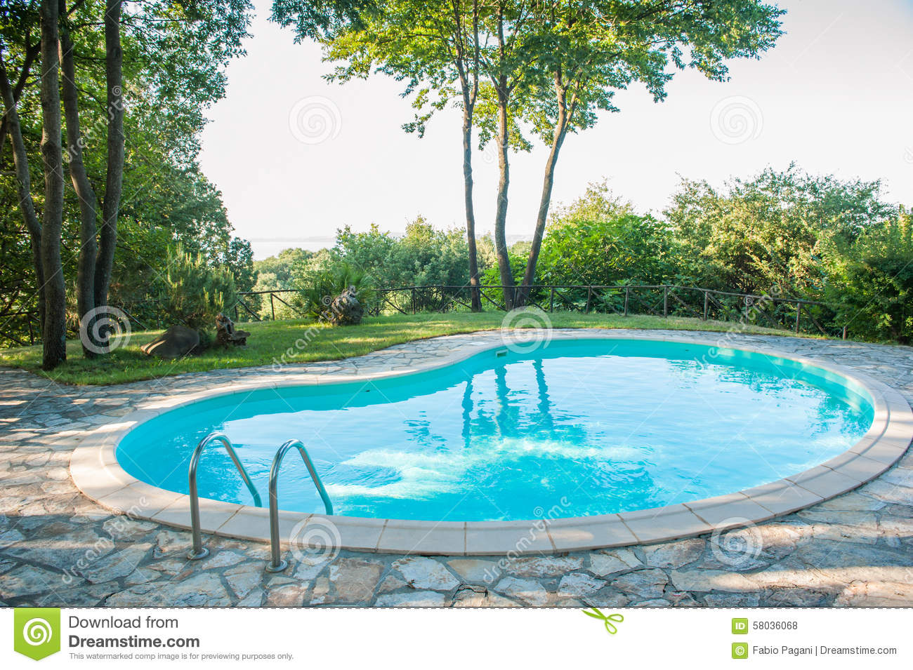 Empty swimming pool in garden between trees stock photo for Unused swimming pool