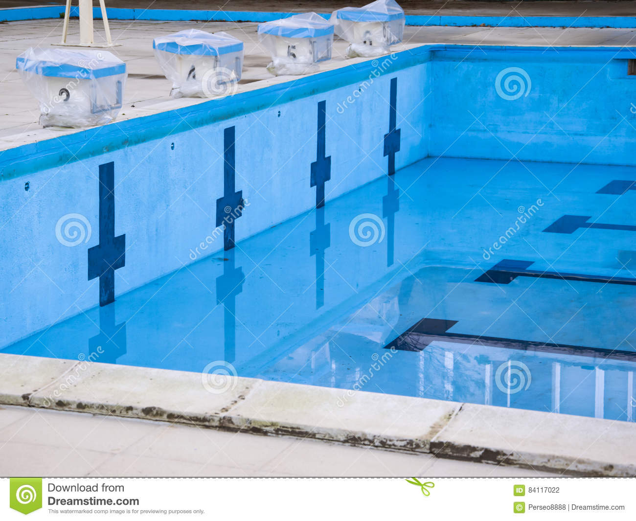 Starting block and empty swimming pool royalty free stock for Swimming pool dealers