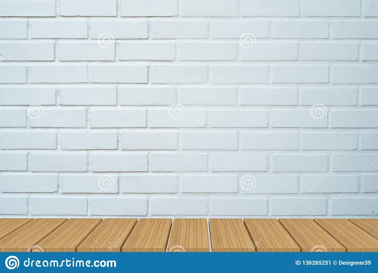 Empty table in front of white brick background.