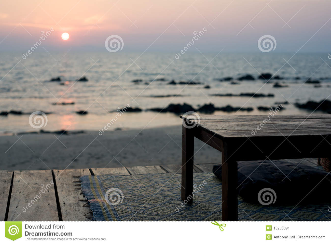 Empty table - rustic beach bar at sunset