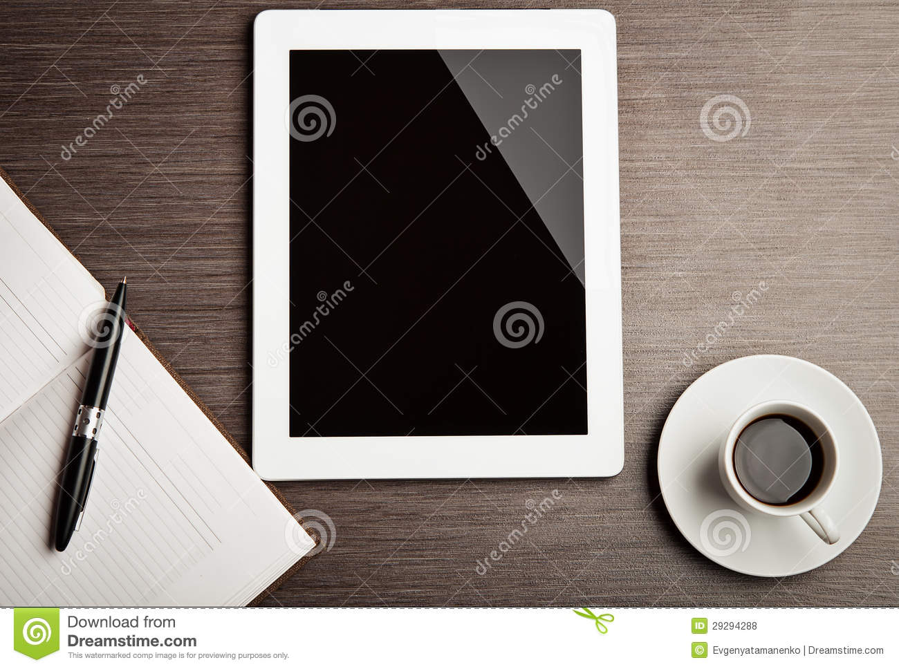 Empty tablet and a coffee on the desk