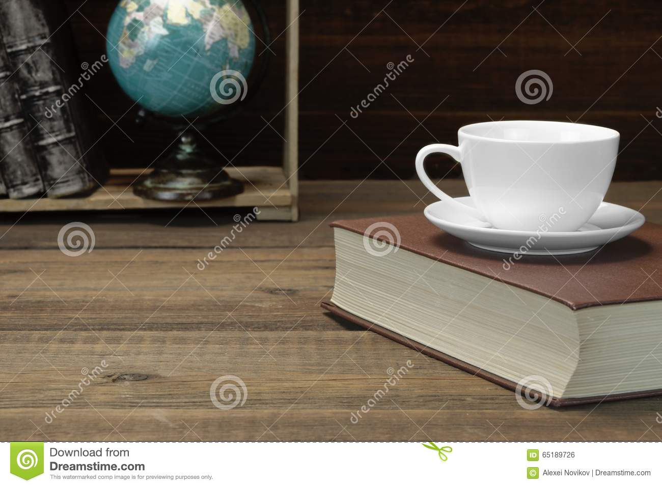 Empty Tea Cup On The Red Old Book And Bookshelf