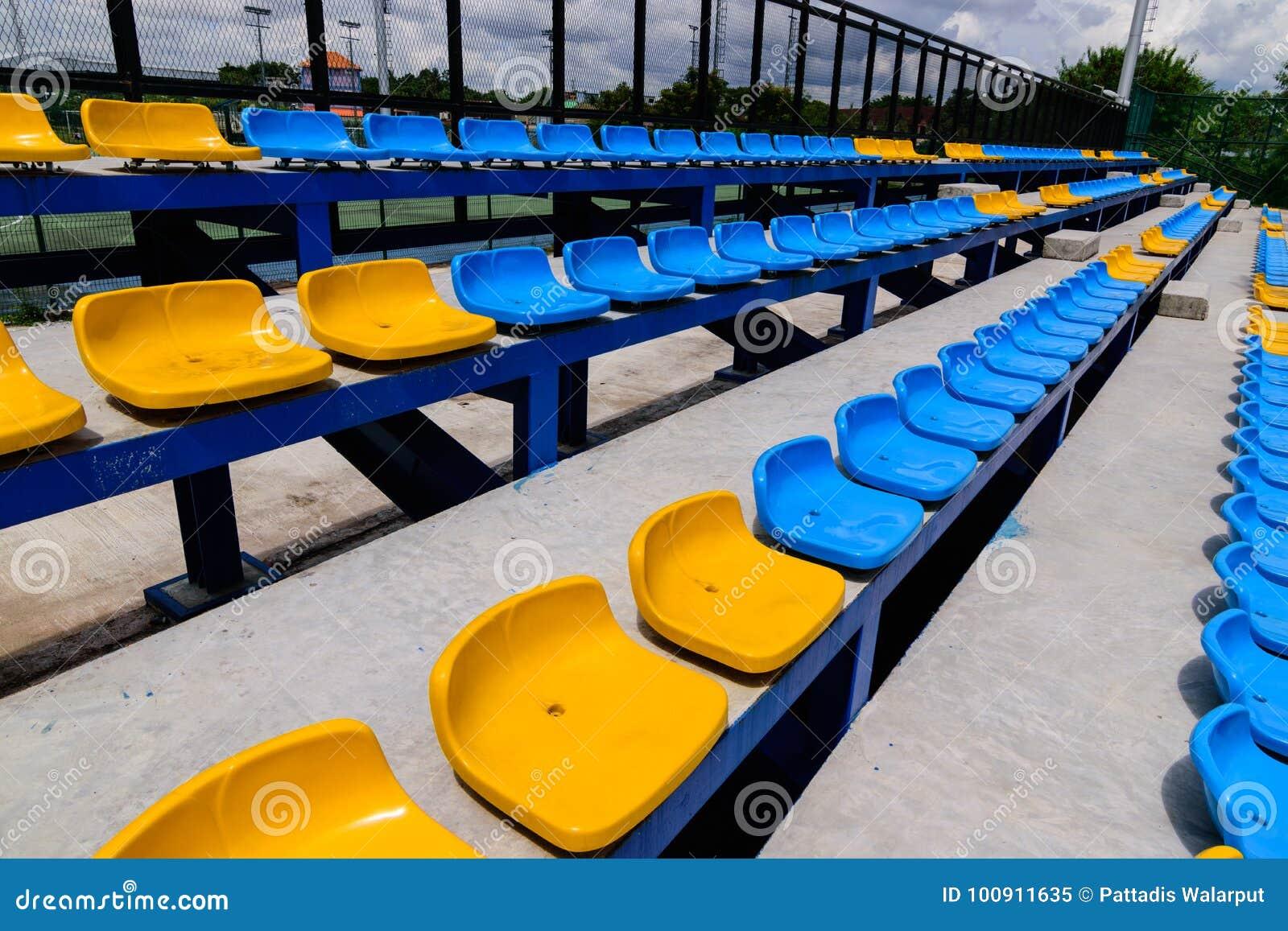 Empty Tennis Court Chairs