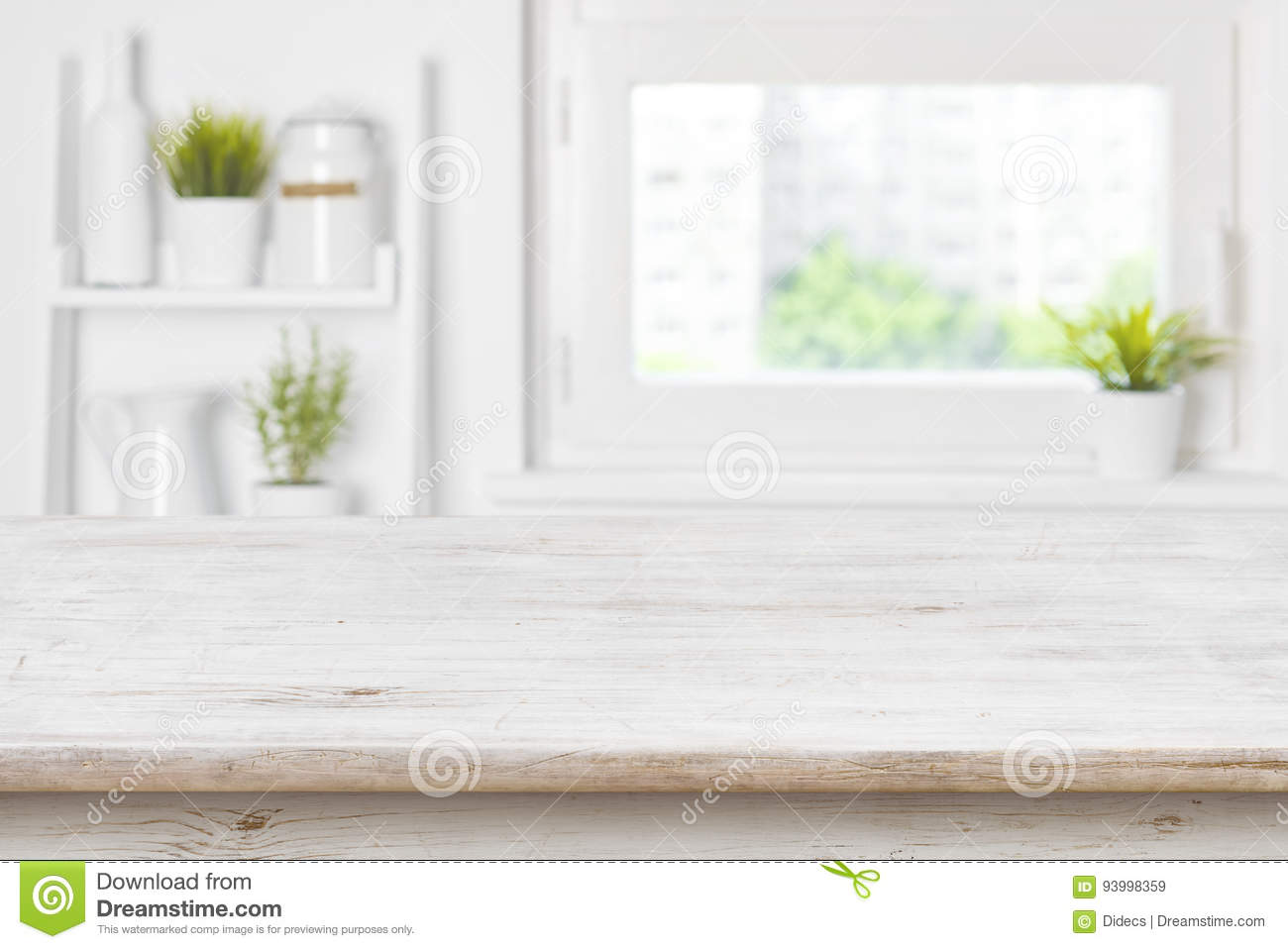 Empty textured wooden table and kitchen window shelves blurred background