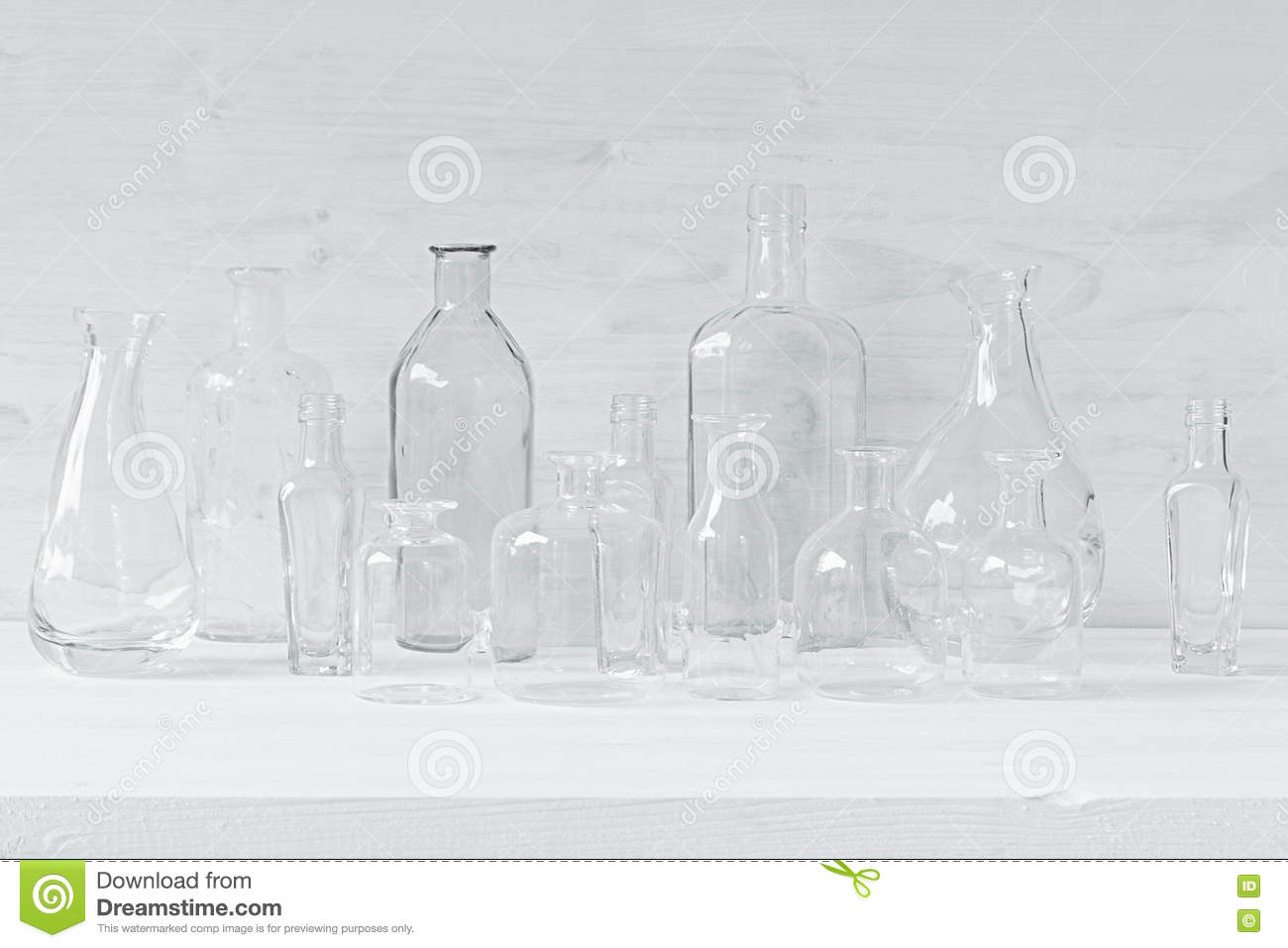 Empty Transparent Bottles On A White Wood Background Stock Image