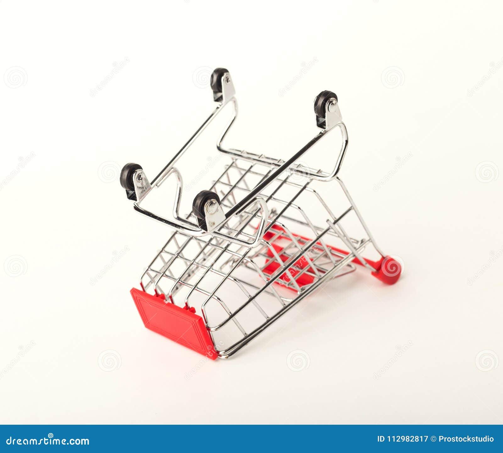 Empty upturned shopping cart isolated on white background