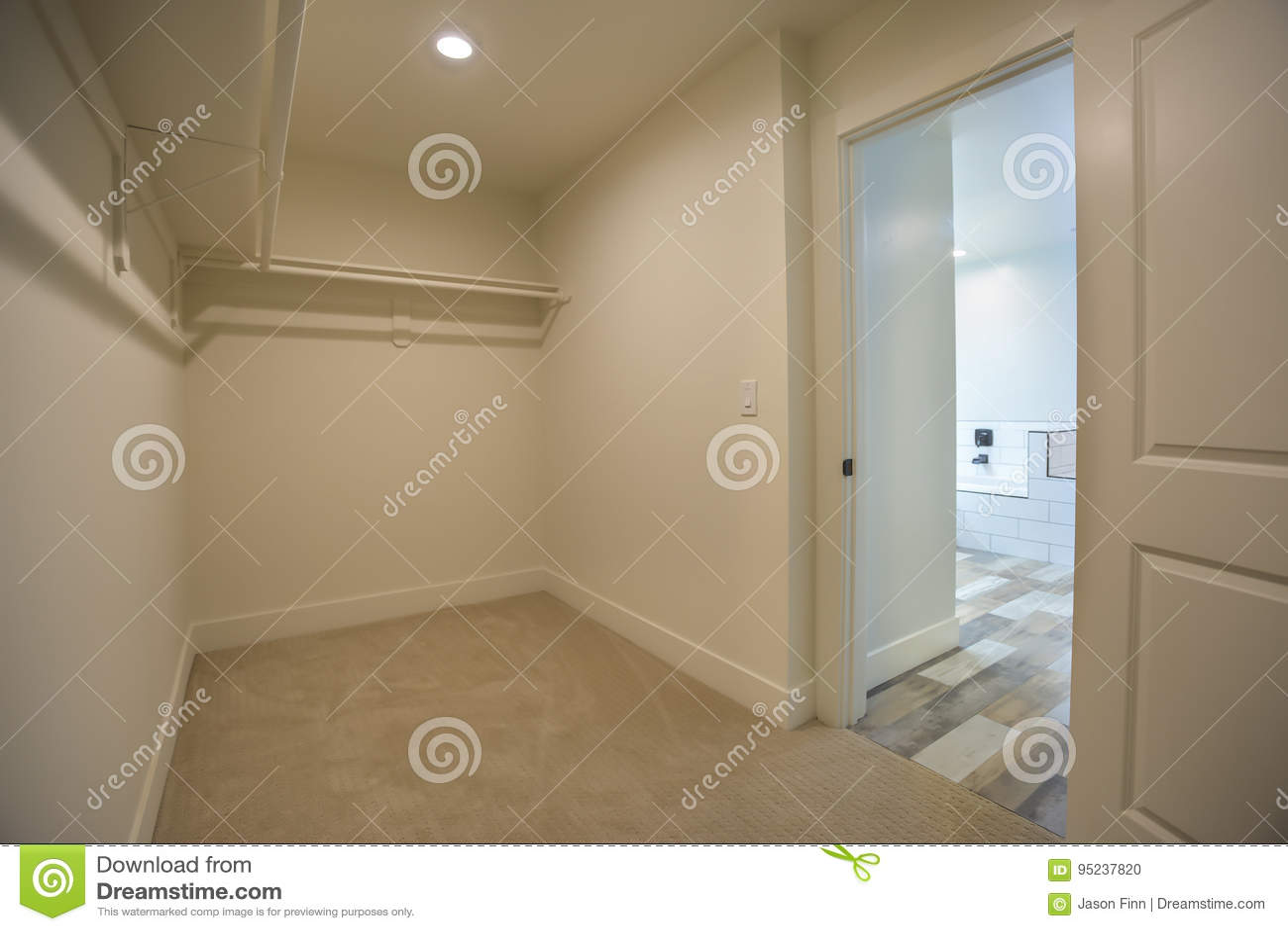 Empty Walk In Closet In Master Bedroom Bathroom In Model Home In San Diego  California