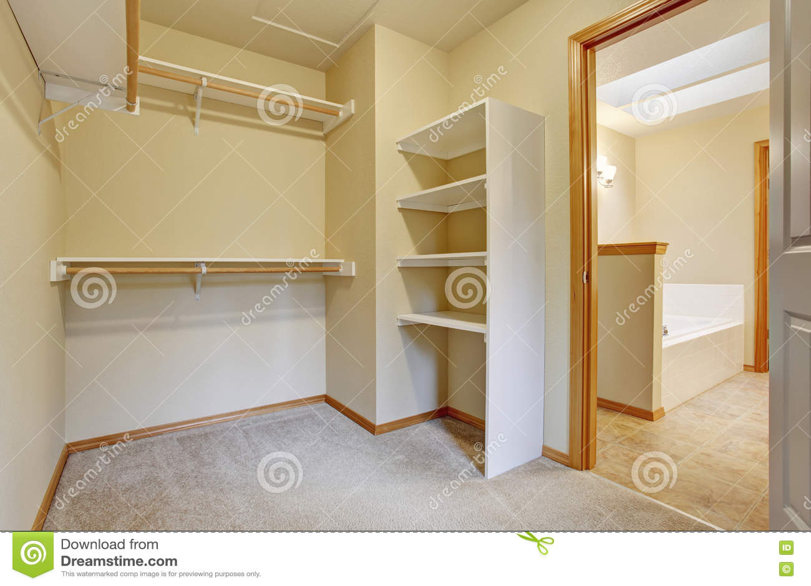 Empty Walk In Closet With Wood Shelves Beige Carpet Floor Stock Photo 74598294