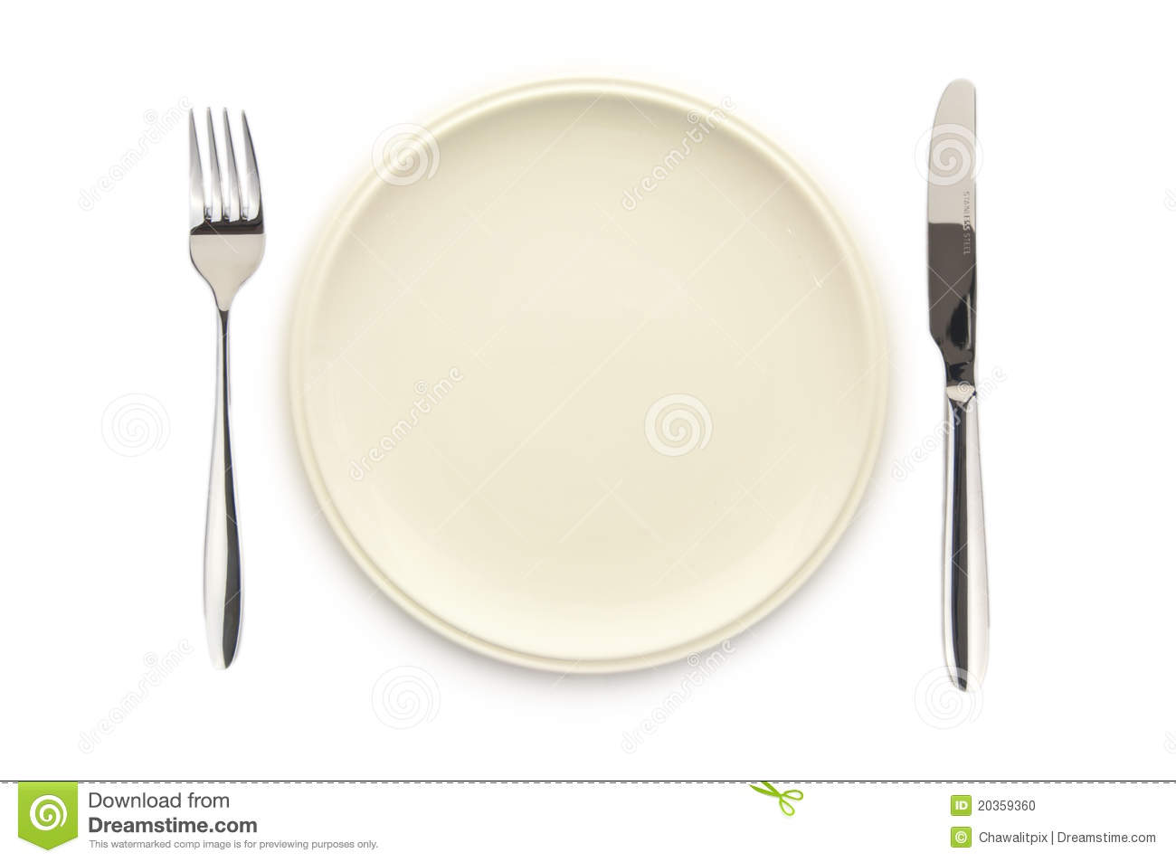 An empty white dish with knife and fork on a table - Empty White Dish Knife And Fork Stock Photo