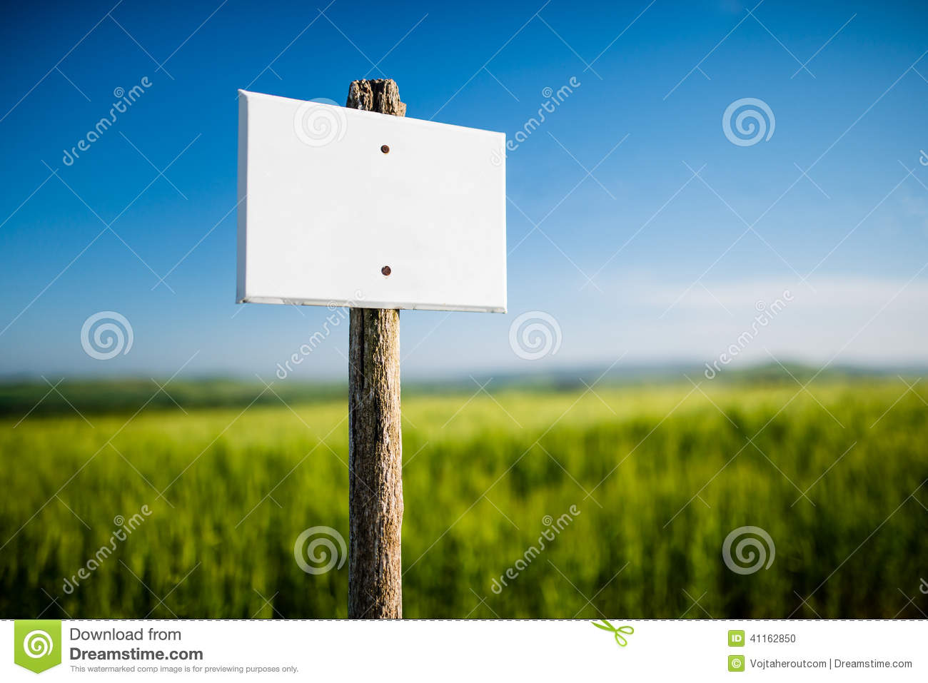 Empty white signboard with vintage wooden post and beautiful nature in the background