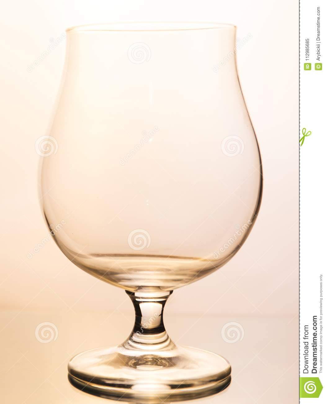 Empty wineglass on white background