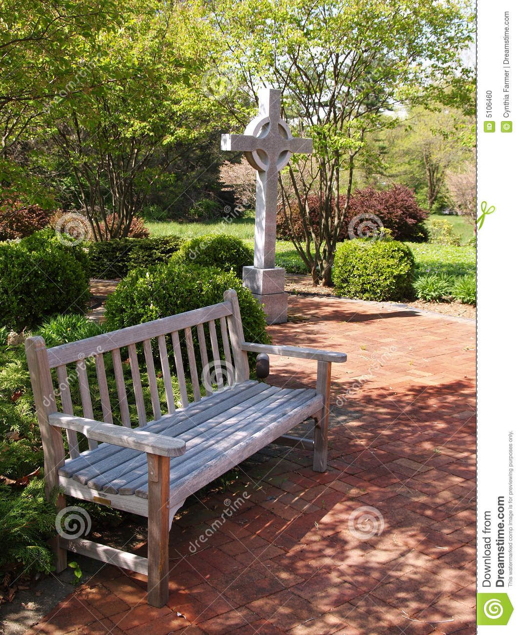 An Empty Wood Bench By A Cross And Red Brick Patio Stock Photo - Image ...