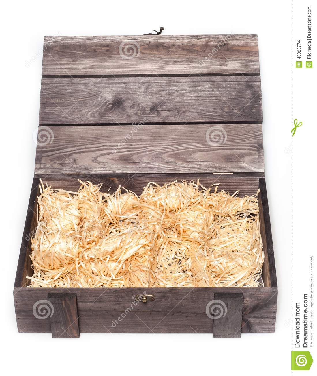 empty wood gift box with straw stock photo