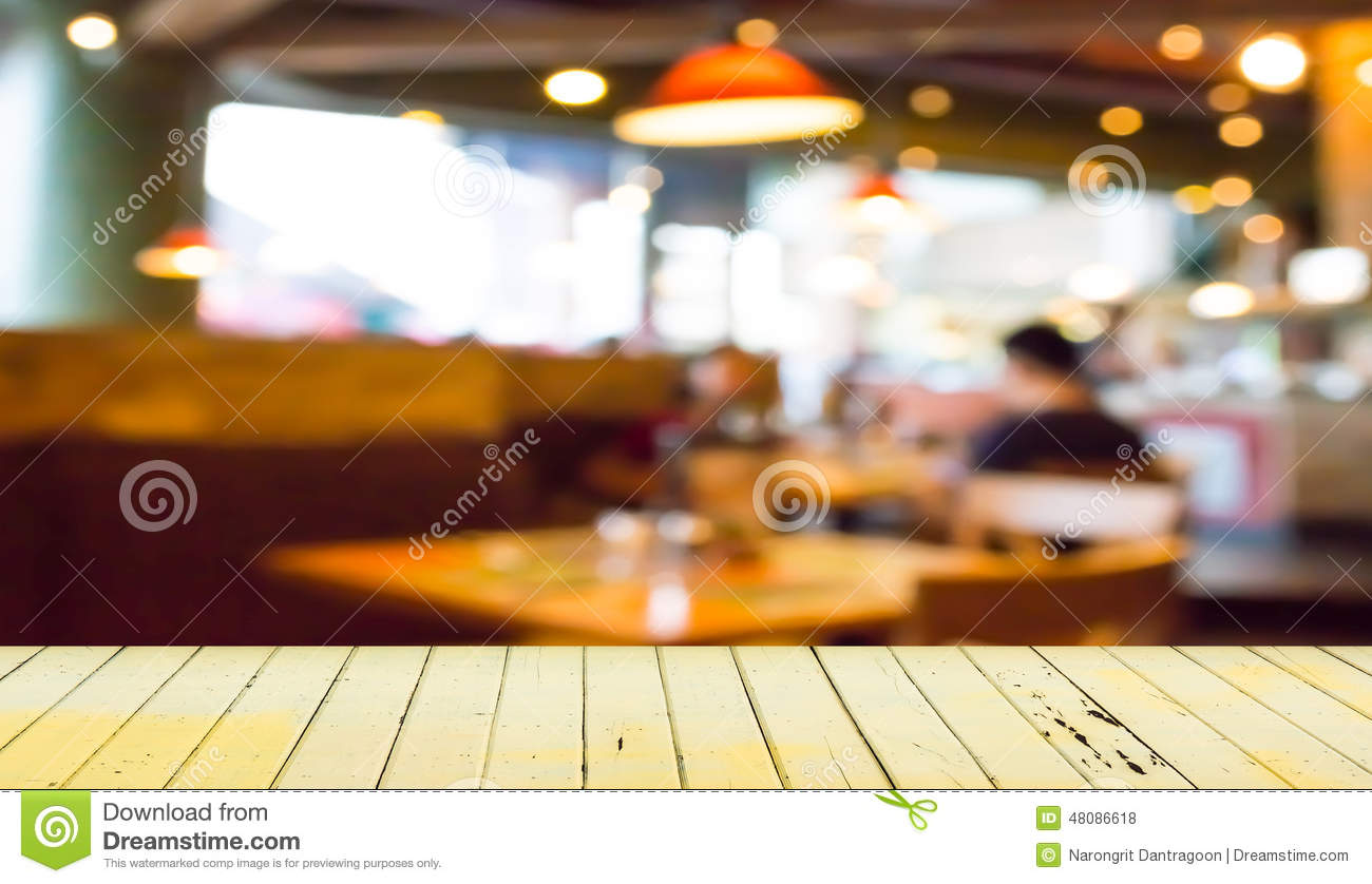 Empty Wood Table And Blurred Coffee Shop Background Stock
