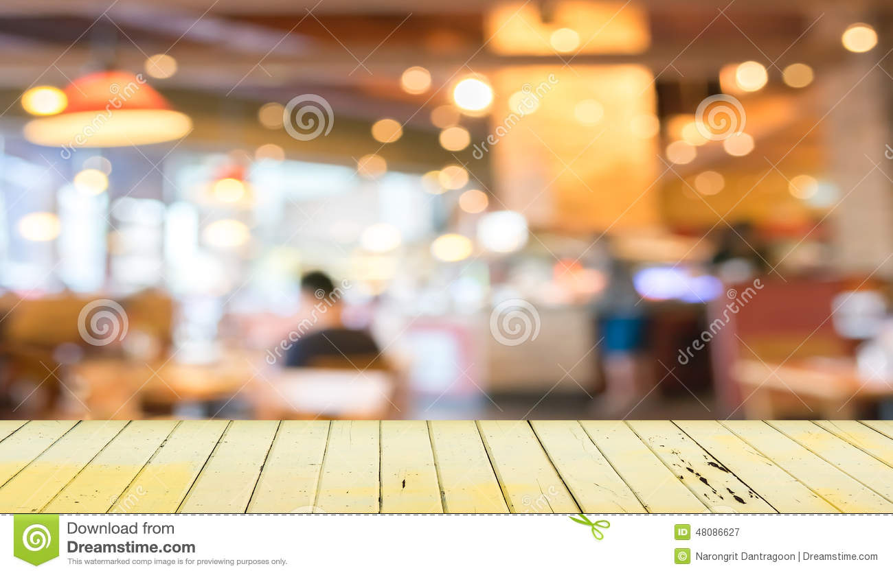 Empty wood table and blurred living room background stock photo - Empty Wood Table And Blurred Coffee Shop Background Royalty Free Stock Photography