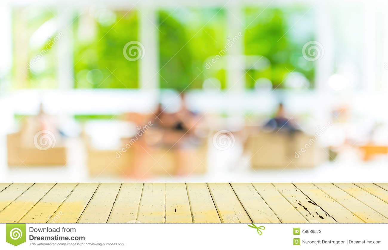 Living Room Background empty wood table and blurred living room background. stock photo