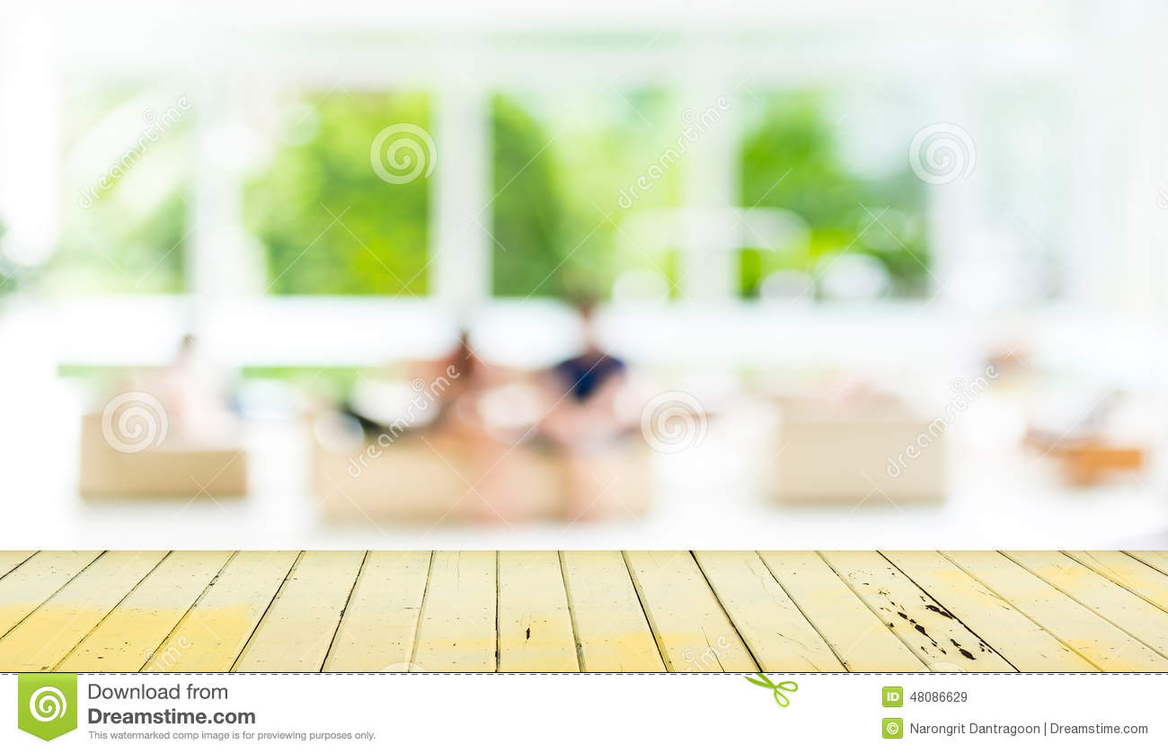 Wooden dining table background - Empty Wood Table And Blurred Living Room Background Royalty Free Stock Images