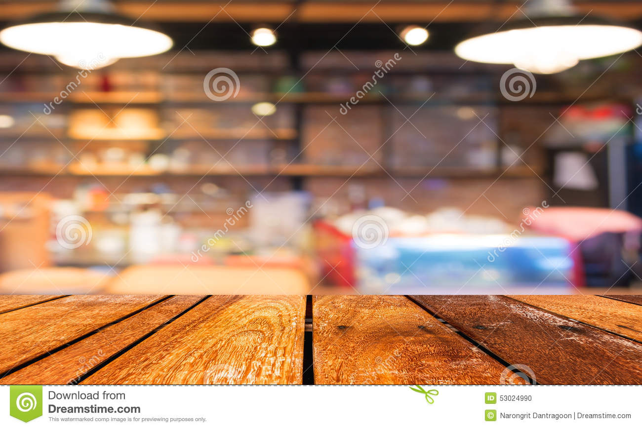 Empty Wood Table And Coffee Shop Blur Background With