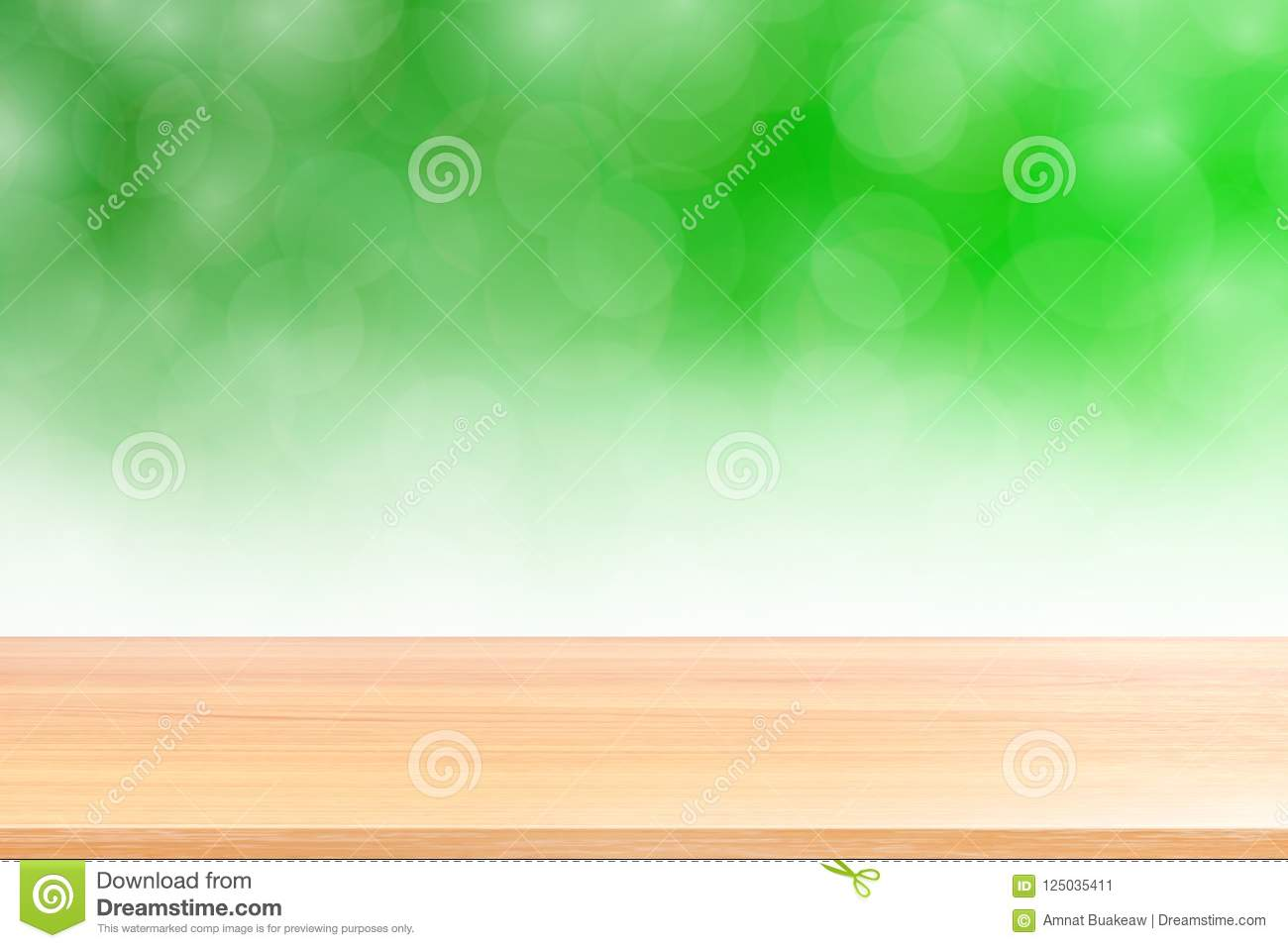 Empty wood table floors on blurred bokeh soft green gradient background, wooden plank empty on green bokeh colorful light shade