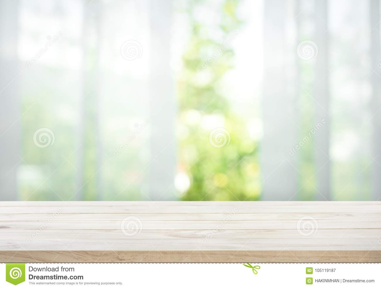 Empty of wood table top on blur of curtain with window view green from tree garden