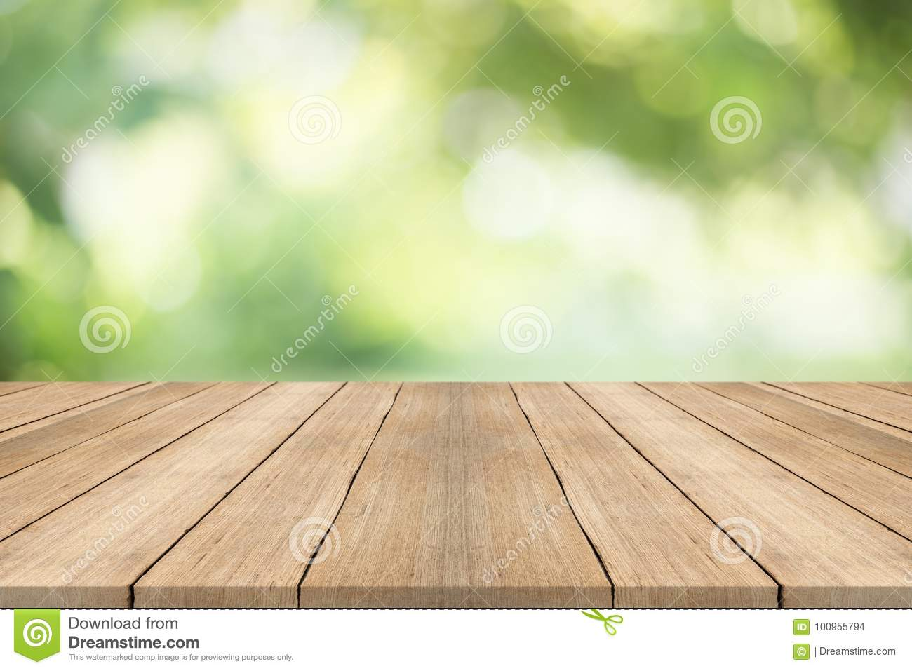 Empty Wood Table Top On Blurred Abstract Green Background