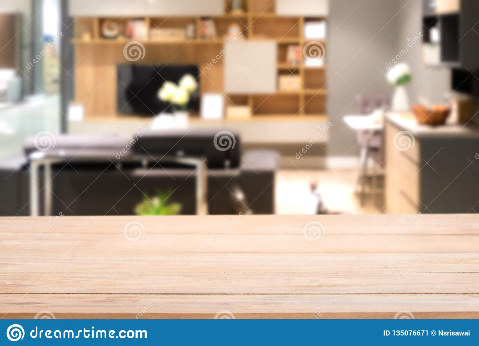 Empty wood table top with Blurred abstract mock up of modern living room interior