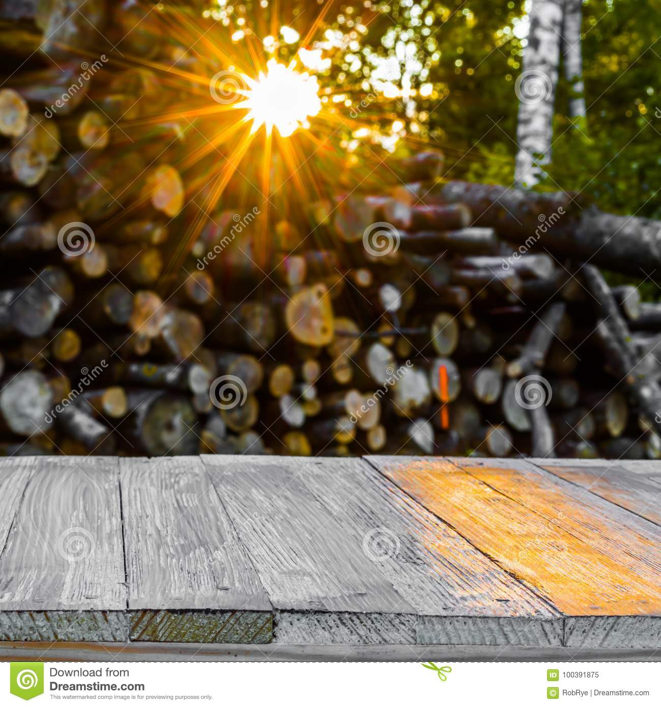 Wood Table Top On Blurred Beach Background Vintage Tone: Empty Wood Table Top On Blurred Bunch Of Logs. Can Montage