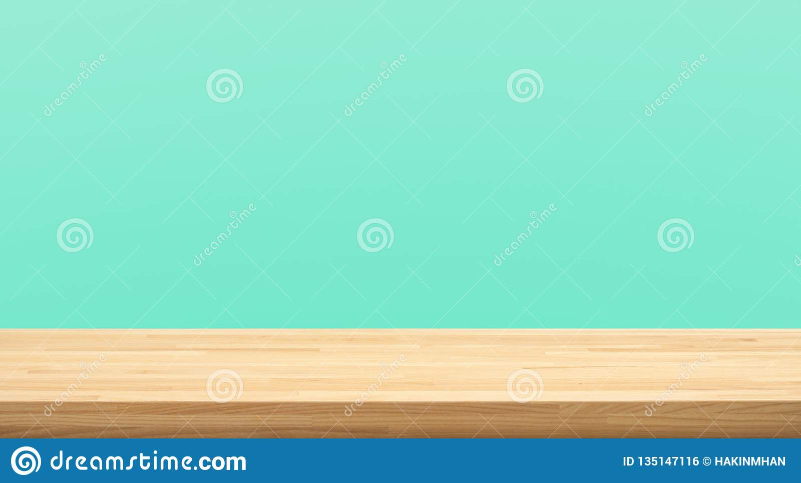 Empty of wood table top on green pastel color background.For montage product display or design key visual