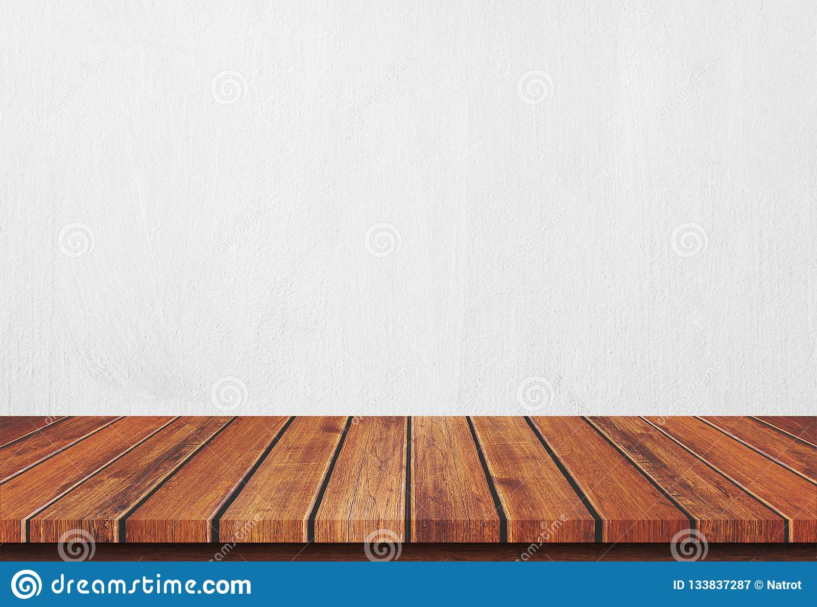 Empty wood table top on white concrete background