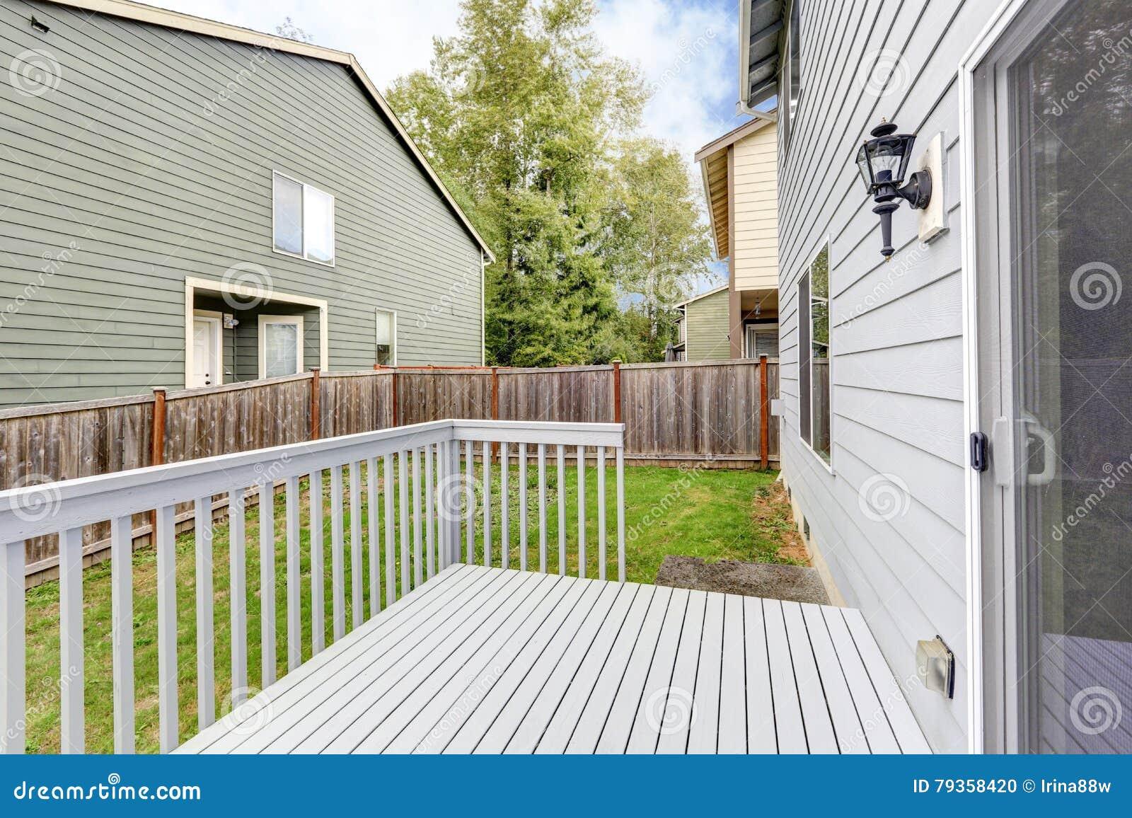 Empty Wooden Backyard Deck Overlooking Neighboring Houses