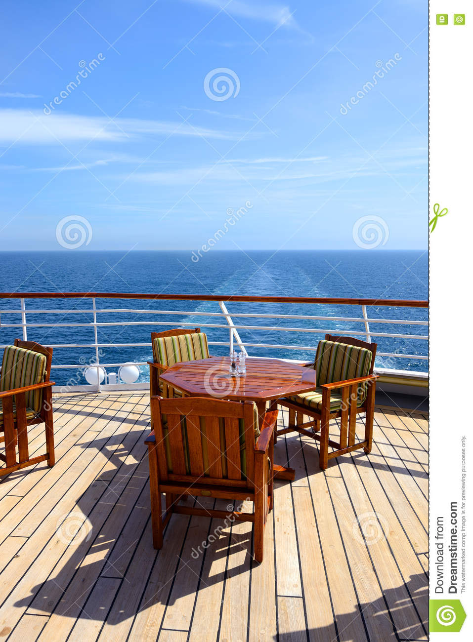 Empty Wooden Deck Chairs And Table On Ship Stock Image ...