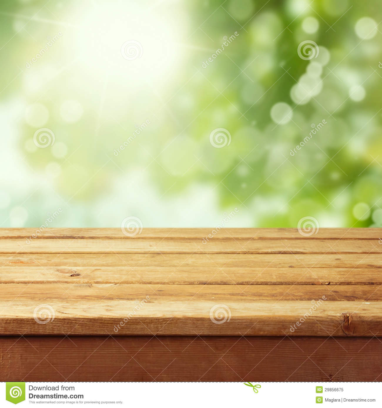 Empty Wooden Deck Table With Foliage Bokeh Stock Image