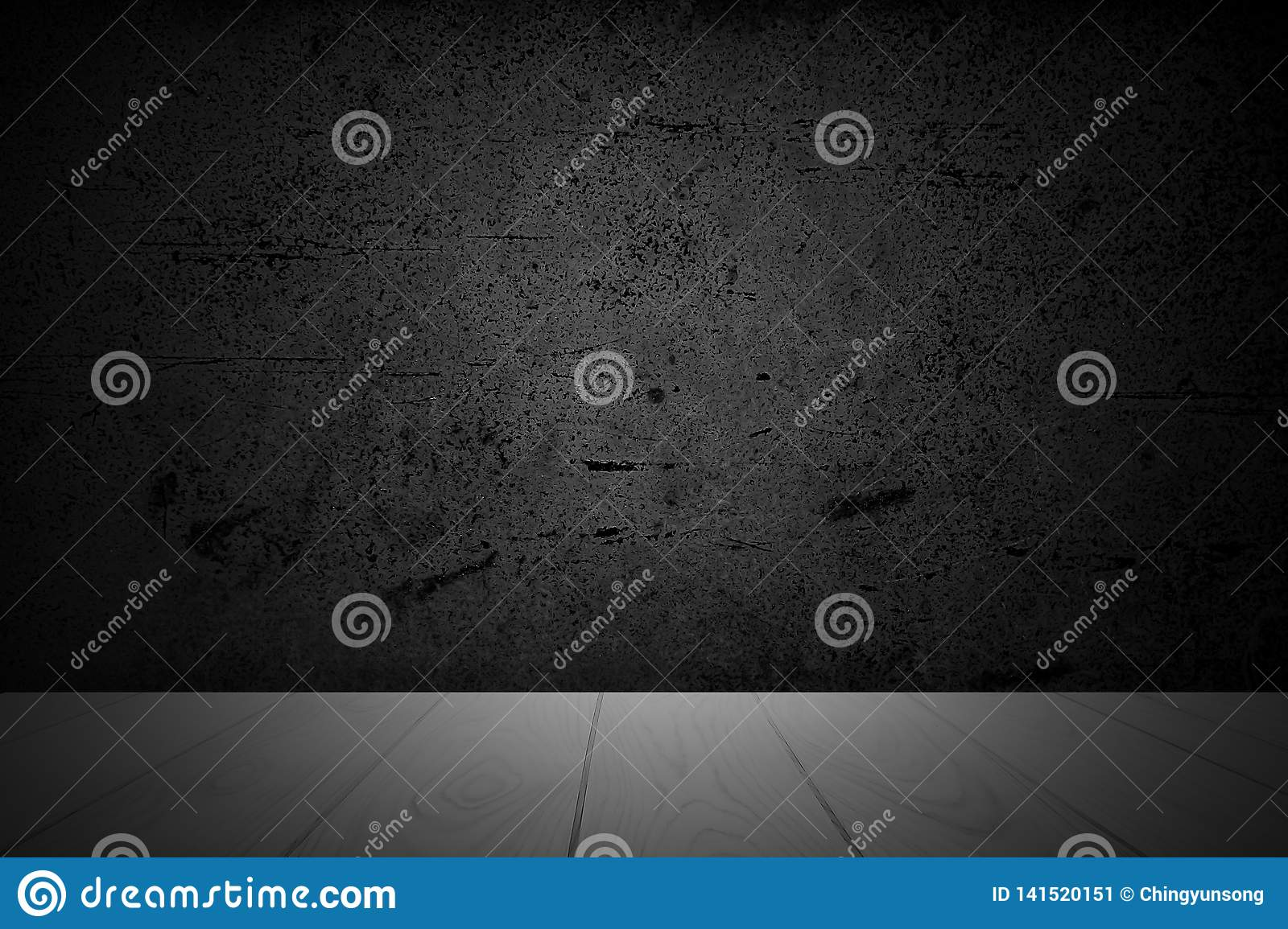 Empty wooden deck table over abstract black background with rough distressed aged texture for present product