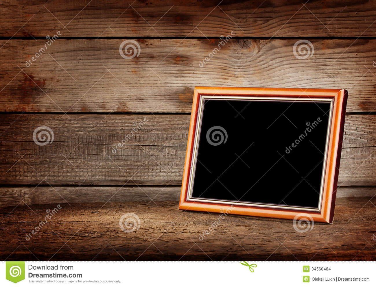 Picture frame on table frame on a wooden table