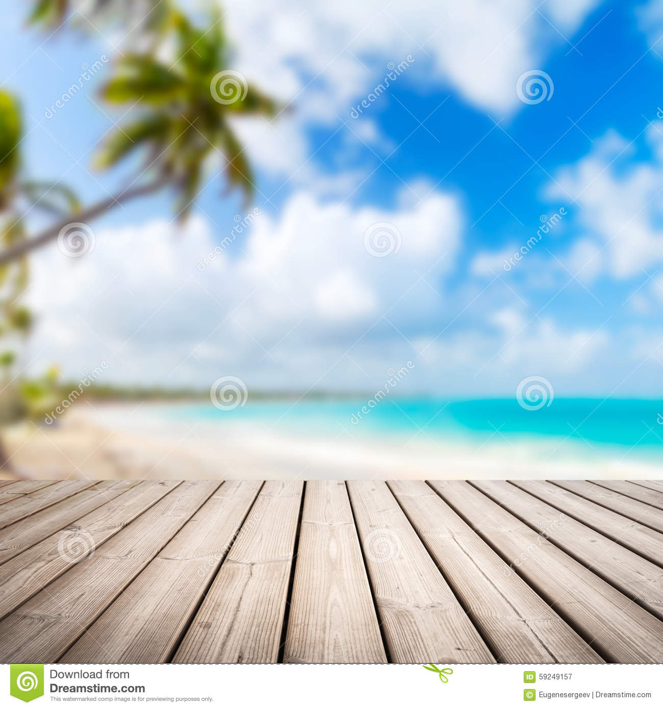 Background Of Blurred Beach And Sea Waves With Bokeh: Empty Wooden Pier Over Blurred Tropical Beach Stock Photo