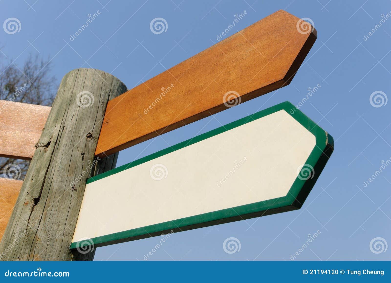 Empty wooden road sign