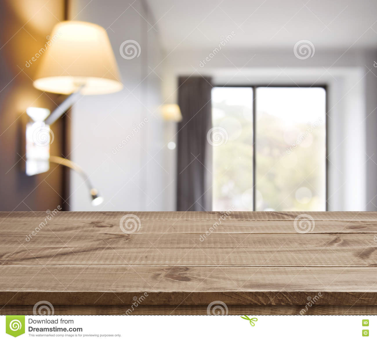 Empty wood table and blurred living room background stock photo - Empty Wooden Table On Defocused Simple Hotel Room Interior Background Royalty Free Stock Photos
