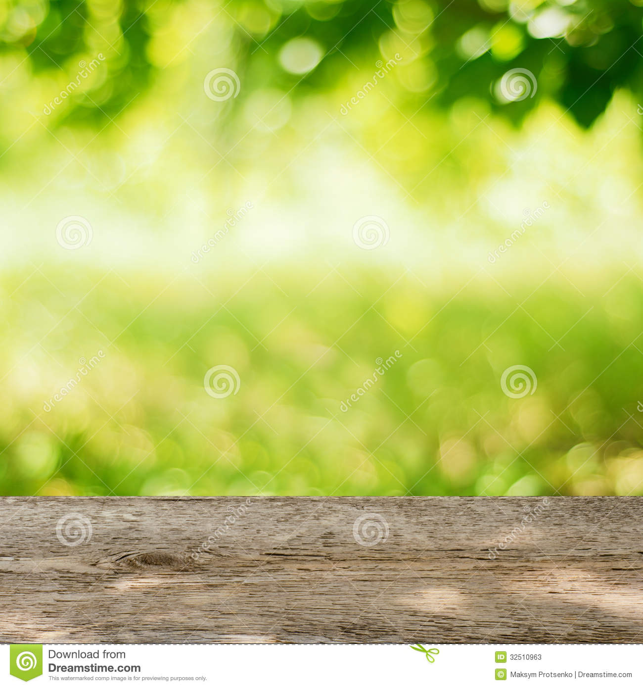 Empty Wooden Table In The Garden With Bright Green Background Stock ...