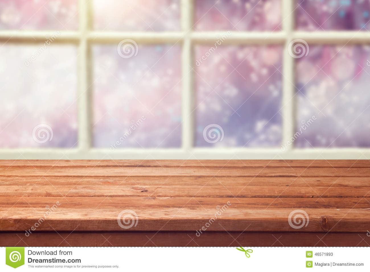 Empty wooden table over window with winter background