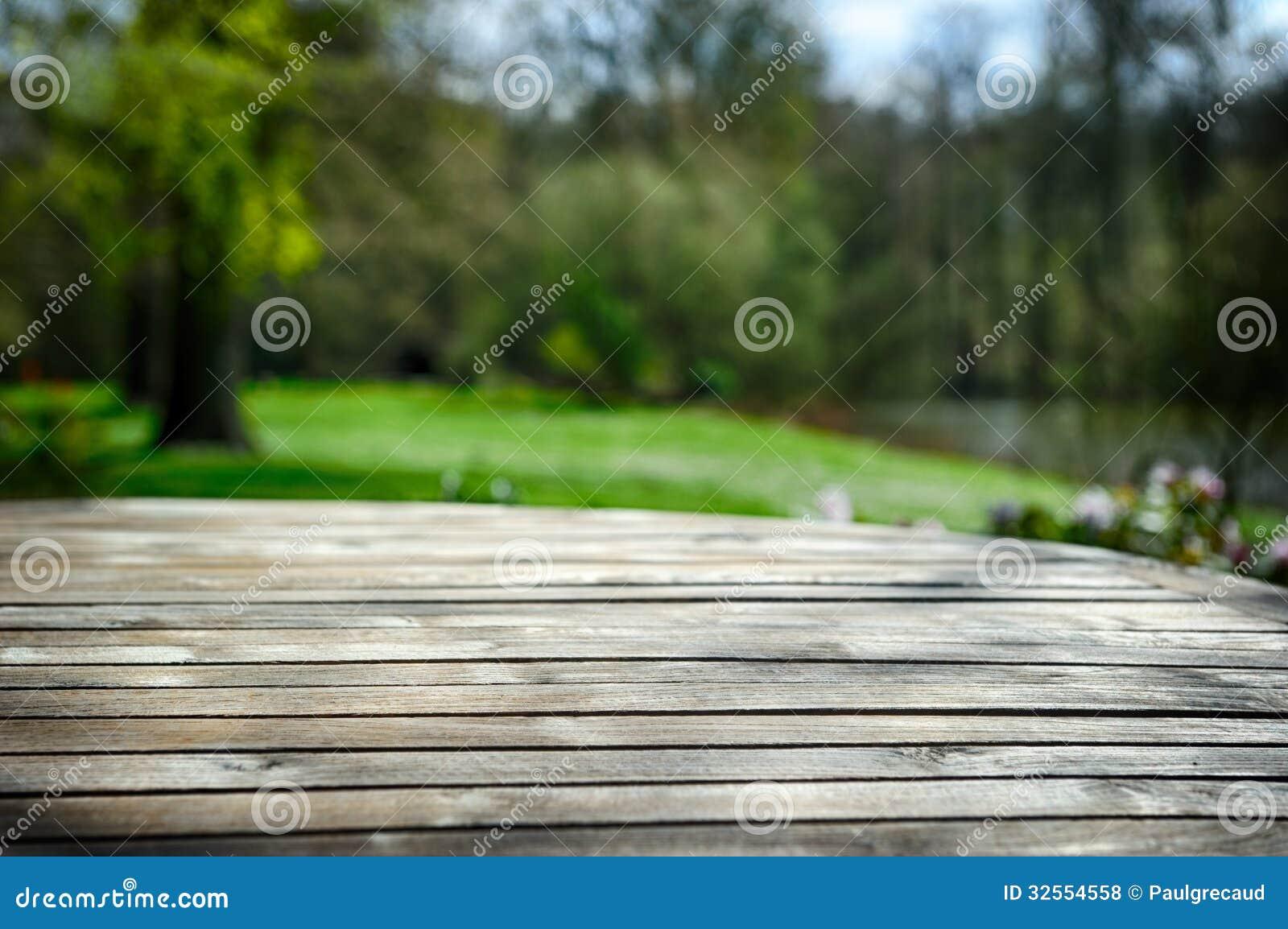 Empty wooden table in spring garden