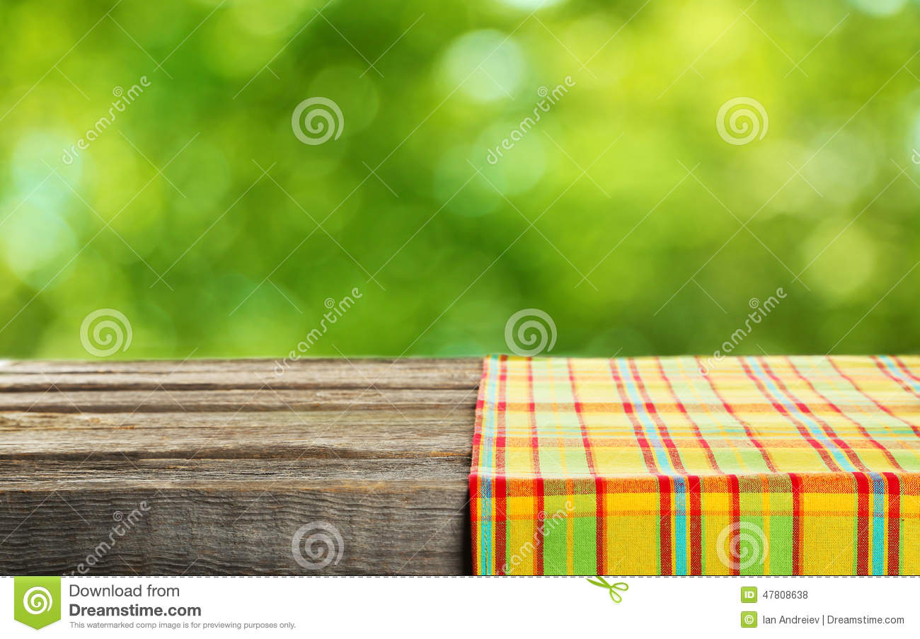 Empty wooden table with tablecloth close up stock photo