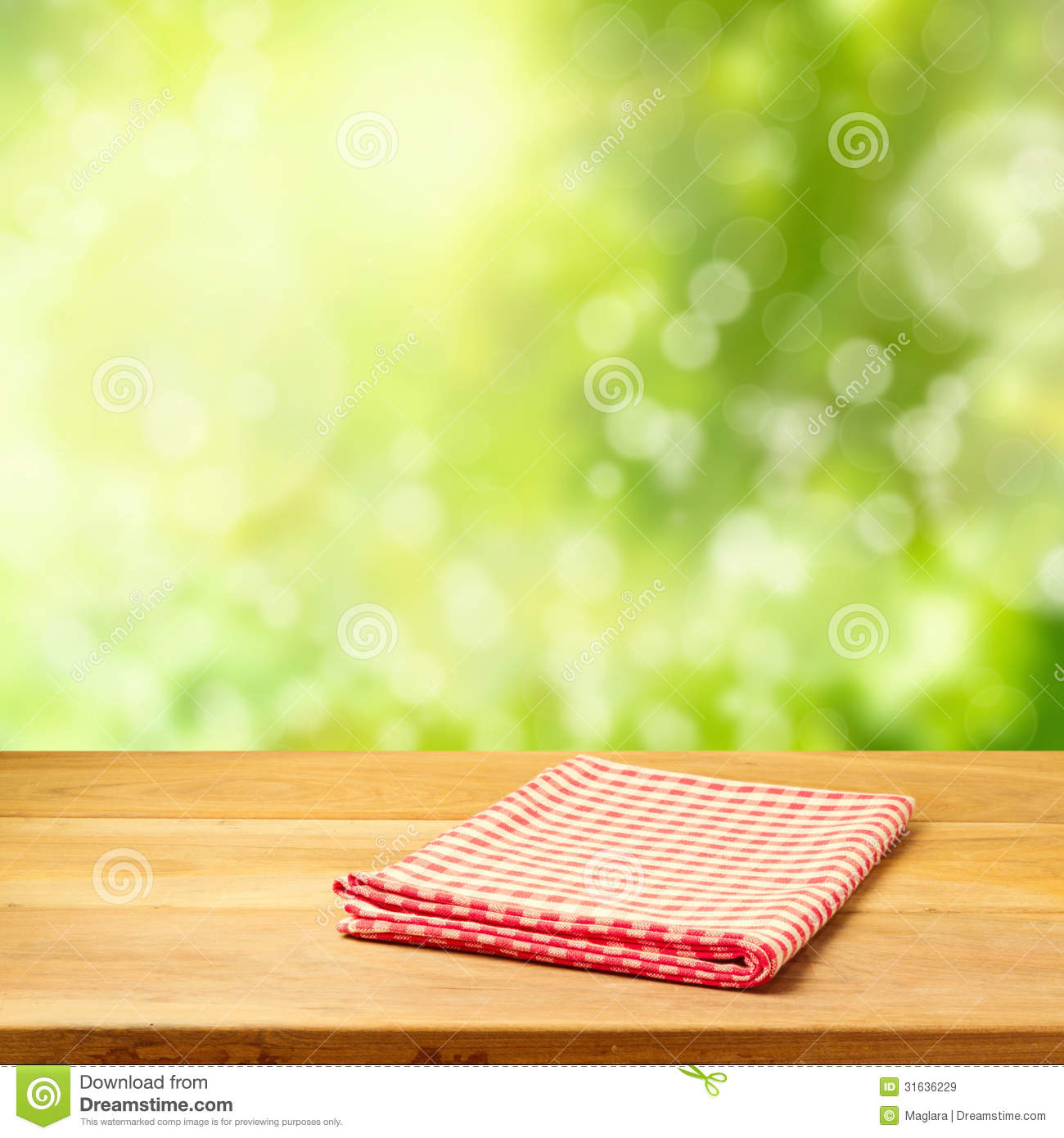 Empty Wooden Table With Tablecloth Over Garden Bokeh ...