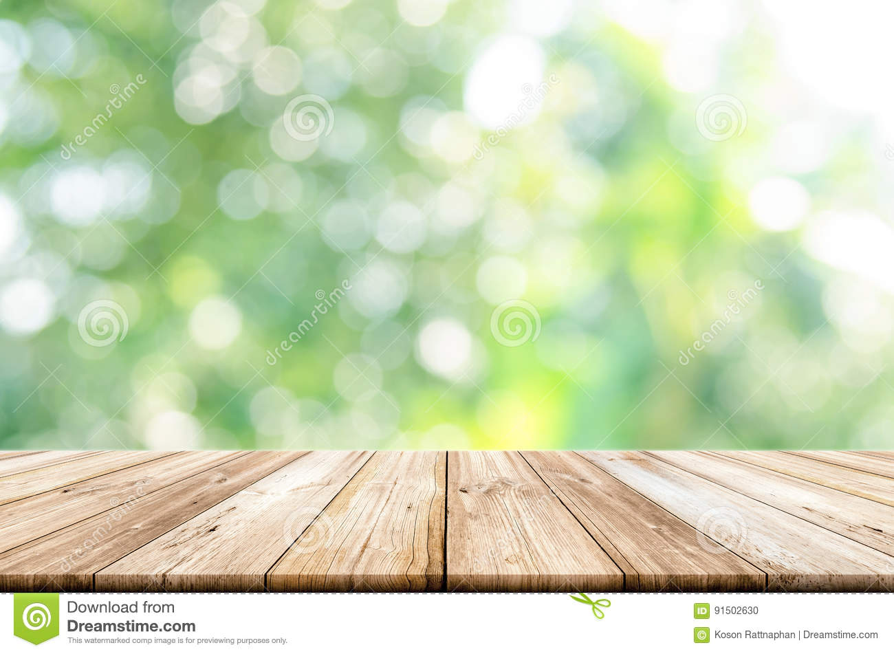 Empty Wooden Table Top With Blurred Green Garden ...